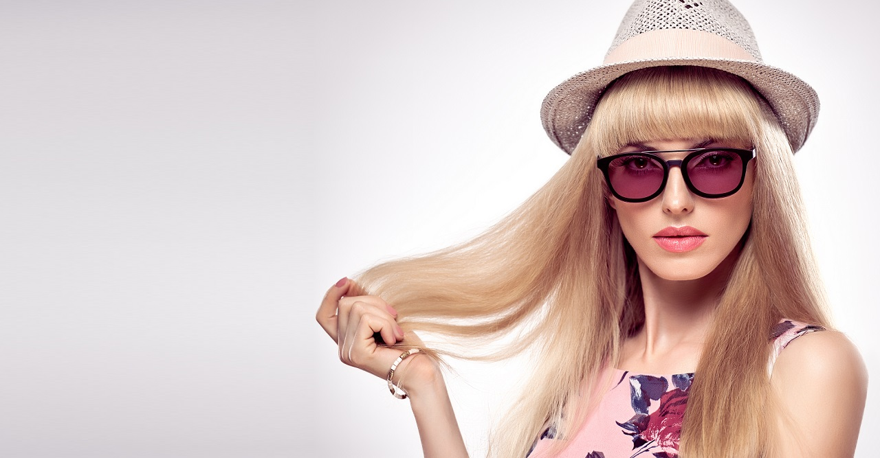 Fashion Portrait Blond Woman in Stylish glasses.